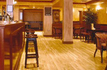 "Elegant wood effect Polyflor Kudos PU luxury vinyl tiles - from commercial flooring specialists Polyflor  - add an extra touch of class to the new ""Sophisticats"" bar at the Hamilton Town Hotel in Hamilton, near Glasgow, UK."
